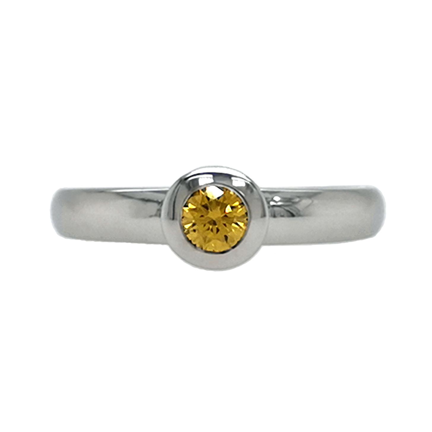 Brillantring aus 585 Weißgold mit gelbem Diamanten, beh., Brillantschliff, ca. 0,25 ct