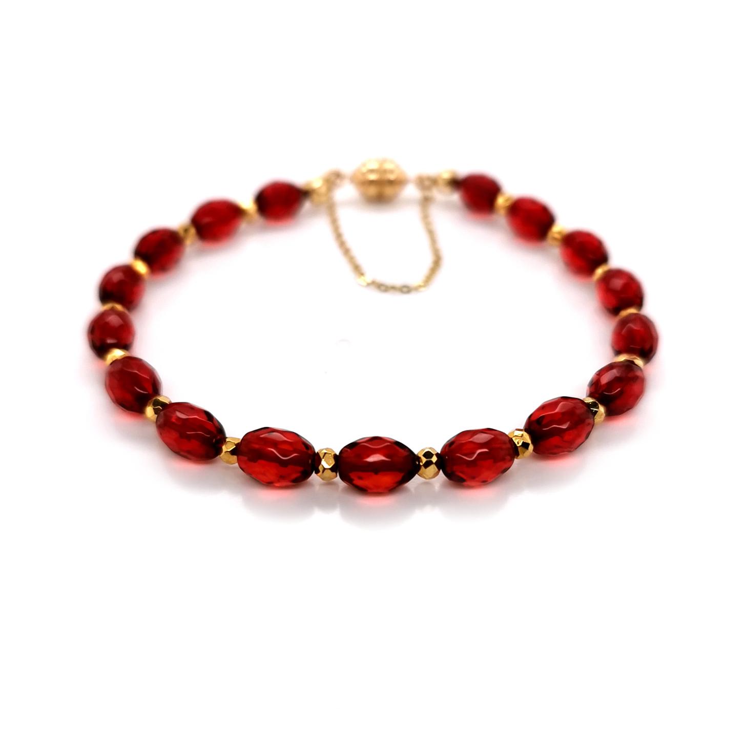 Armband mit rotem Bernstein / Copal & goldcoated Pyrit, Magnetschließe Carat 3000, 375 Gelbgold